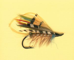 Brightly colored hand-tied salmon fly.